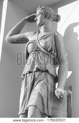Statue of Artemis in St. Petersburg Russia. Black and white. Artemis - in ancient Greek mythology always a young goddess of hunting the goddess of fertility the patroness of all life on Earth.