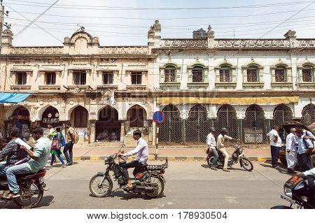 MYSURU, INDIA - FEB 20, 2017 Vehicles on busy Indian street with pedestrians bikes and cars in Karnataka state on February 20, 2017. Population of Karnataka is 62000000 people