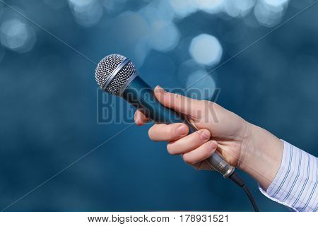 Hand Of A Businesswoman With A Microphone .