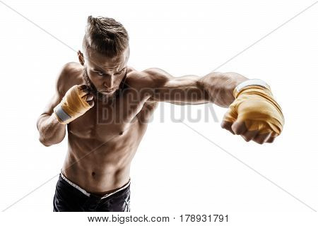 Muscular man throwing a fierce and powerful punch. Photo of sporty man isolated on white background. Strength and motivation