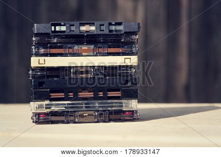 Filtered Retro Compact Cassette Audio Magnetic Tapes On Wooden Background