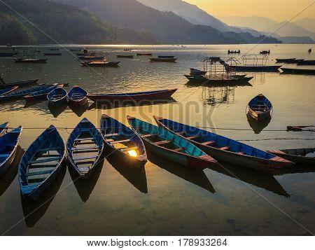 Sunset empty boats scene in the lake Phewa Pohkara Nepal