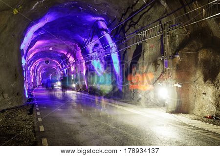 STOCKHOLM SWEDEN - MAR 25 2017: Blue light in tunnel and a group of ghost like runners in the Stockholm Tunnel Run Citybanan 2017. March 25 2017 in Stockholm Sweden