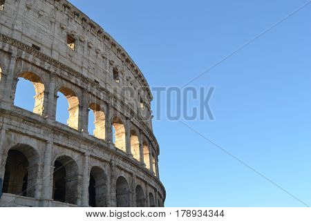 Colosseum in Rome. Rome Italy. Amphitheater in Rome. Colosseo. Roman Empire. Colosseum with blue sky. Symbol of Rome. Close-up Colosseum.