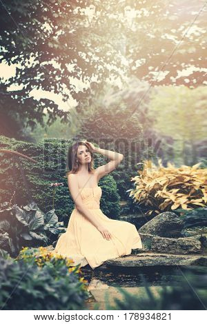 Spring Model Woman wearing Prom Dress on Fantasy Background. Beautiful Girl Outdoors