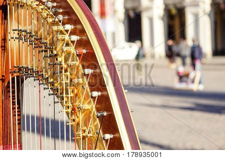 Part of musical instrument called harp in abstract background
