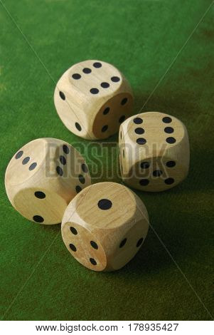 close up of the dices on green table