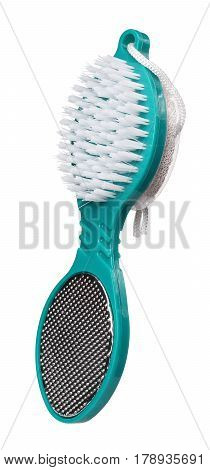 Pumice stone brush of green color isolated on white background. Close up. Foot care.