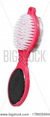 Pumice stone brush of red color isolated on white background. Close up. Foot care.