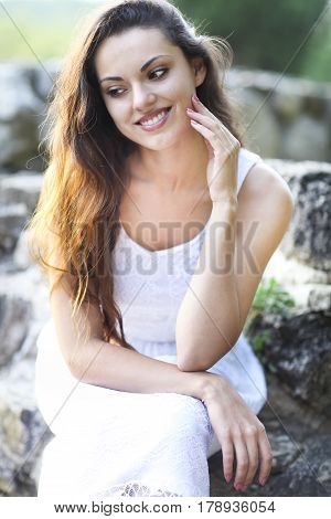 Young beautiful natural brunette woman at summer sunset portrait. Happiness fun and harmony concept