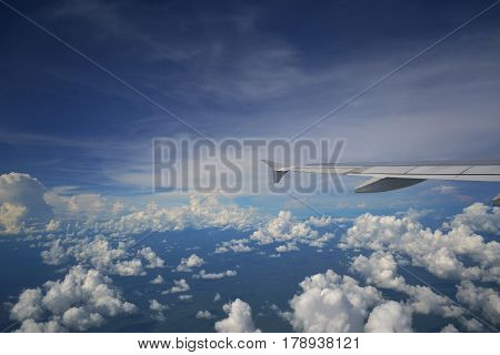 Beautiful blue sky. Airplane window view. Breathtaking sky. Peaceful sky. Blue sky. Airplane wing view. Airplane wing in the blue sky. View from a plane window.