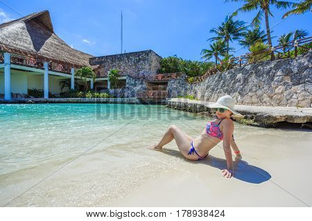 Woman relaxing on the caribbean beach in Mexico