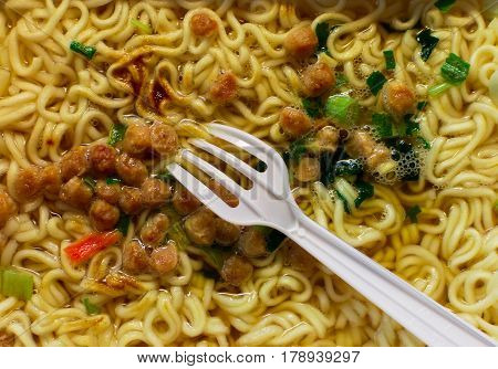 Ready-made instant noodles with spices. Close-up view from above.