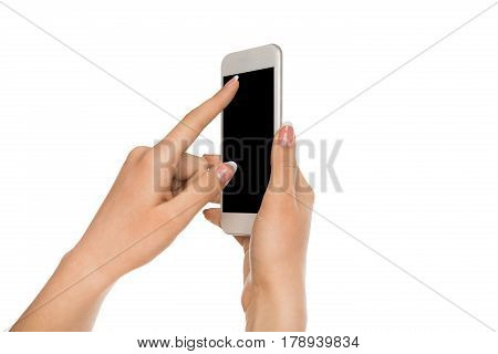 Touch screen with copy space. Mobile phone display, female hand holding modern smartphone and pointing with index finger on blank screen, white isolated background, copy space, cutout
