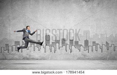 Young businessman in room running in a hurry