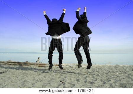 Two businessmen jumping and celebrating on the beach poster