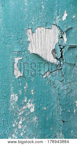 abstract wooden background with cracks on the blue paint plaster
