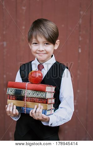 Portrait Of A First-grader Standing With Books