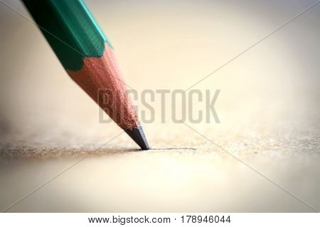 Graphite Pencil line on a Paper Sheet extreme closeup the graphite is only couple of millimeters long
