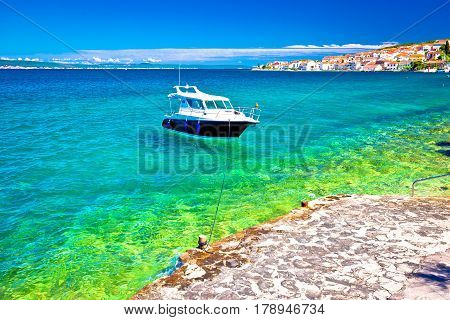 Kali Beach And Boat On Turquoise Sea