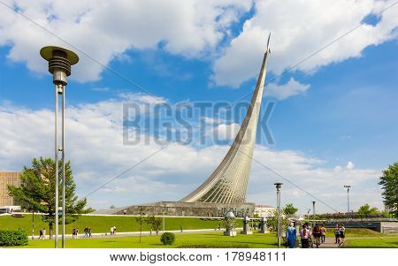 MOSCOW - MAY 8 2016: People walking near monument to the Conquerors of Space. It was build in 1964 to celebrate achievements of the Soviet people in space exploration.