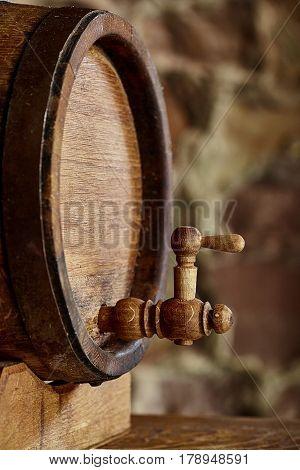 Closeup of cock old oak barrel. Front view.