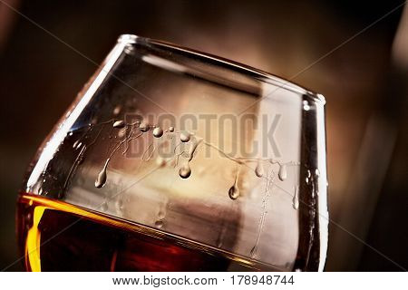 glass with cognac closeup.taste of cognac.athmospheric photo
