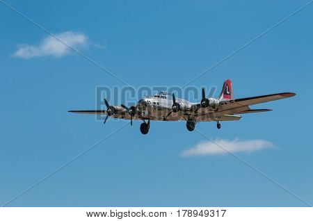 EDEN PRAIRIE MN - JULY 16 2016: B-17G bomber Yankee Lady comes in with landing gear down at air show. This B-17 was a Flying Fortress built for use during WW II but never flew in any combat missions.