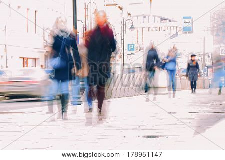 City in the early spring. Street, people walking along the sidewalk, blurred, background, concept shopping, walking, lifestyle. For modern pattern, wallpaper or banner design. With place for your text