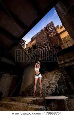 Young Asian Girl Posing In Abandoned Building