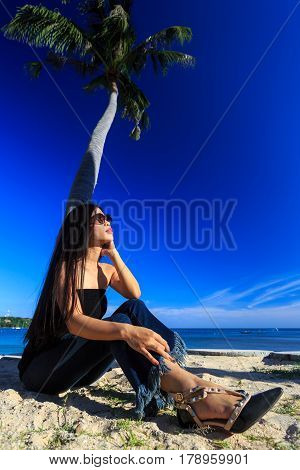 Asian Girl Sitting With Palms Tree