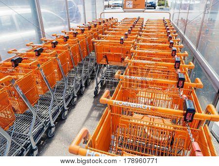 BUCHAREST ROMANIA - APR 1 2016: Supermarket trolley in a row with the Hornbach orange logotype