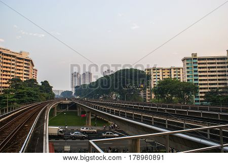 Singapore. MRT Train Tracks on overpass near Ang Mo Kio Station. Аpartment buildings in the background.