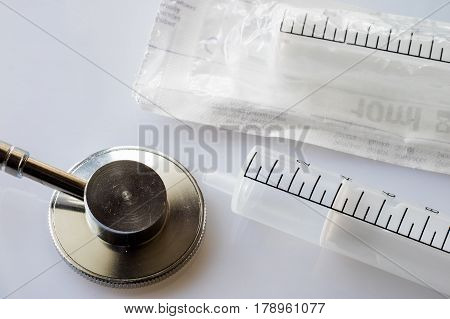syringes and stethoscope on a withe background