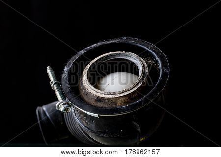 old parts for washing machines on a black background