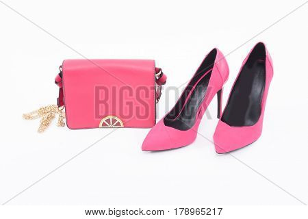 Fashion concept. Pink handbag , shoes on a white background