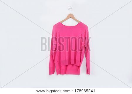female pink dress on hanging