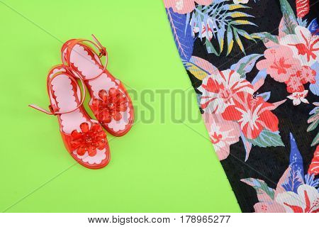 Fashion. Summer woman accessories-Summer floral scarf, shoes on green background