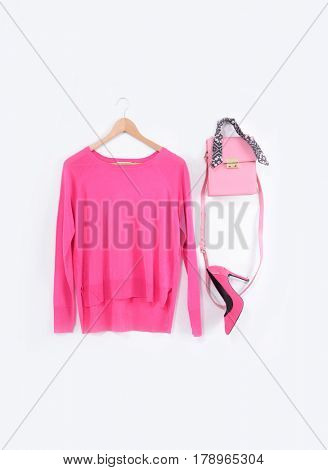 female pink dress  with handbag on hanging