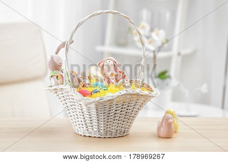 Easter basket with gifts on blurred background