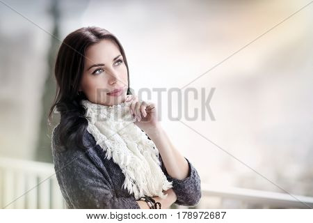 Portrait of a beautiful peaceful woman relaxing outdoors, spending spring day on the terrace in the countryside, enjoying time outdoors