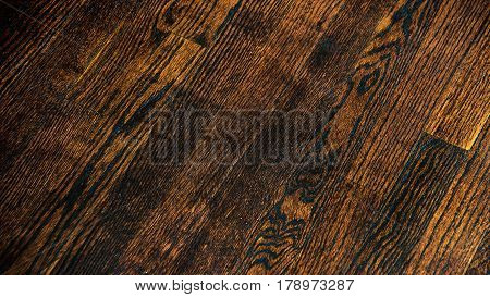 Dark wood floor texture and background. Brown painted wood floor texture background. Old italina wooden floor background. Aged wood planks pattern. Wooden floors. Angled timber floor texture.