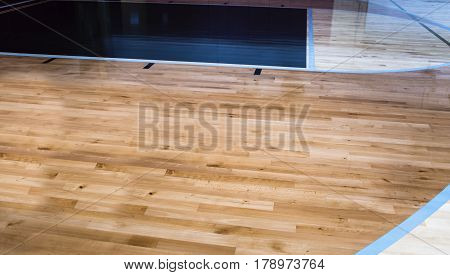 Gym wood basketball floor. Gym floors. Basketball floor. Hardwood basketball floor in the gym. Wood basketball floors in the gym. Basketball flooring. Three different colors of basketball floor.