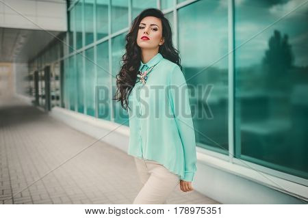 Photo of beautiful young woman with makeup in fashion clothes
