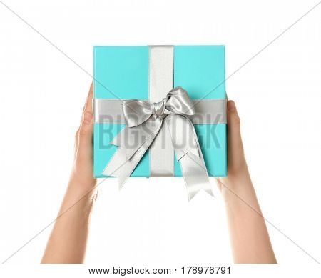 Hands holding beautiful gift box on white background