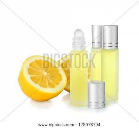 Perfume bottles and lemon on white background