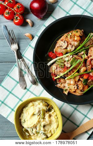 Tasty chicken marsala with vegetables on table