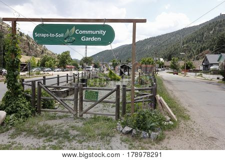Idaho Springs CO USA - June 24 2016: Beautiful Community Garden Scraps-to-Soil and entry signs at 2225 Miner Street. Scraps-to-Soil Community Garden on a summer day