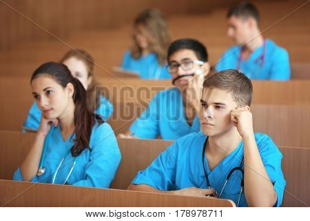 Smart medical students at lecture indoors