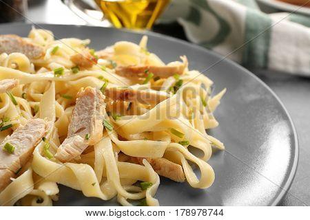 Plate with delicious Chicken Alfredo, closeup